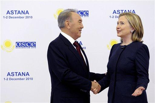 Kazakhstan's President Nursultan Nazarbayev, left, welcomes U.S. Secretary of State Hillary Rodham Clinton upon her arrival for the OSCE Summit at the Palace of Independence in Astana, Kazakhstan, Wednesday Dec. 1, 2010. The OSCE Summit offers a unique opportunity to address urgent security challenges including transnational threats such as terrorism and trafficking, and the recent unrest in Kyrgyzstan and the situation in Afghanistan. (AP Photo/Geert Vanden Wijngaert)