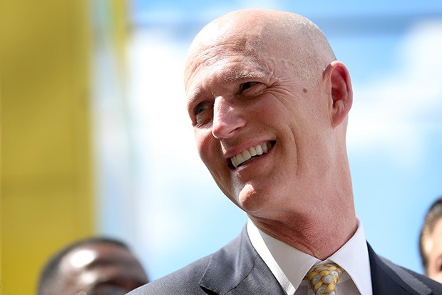 "HIALEAH, FL - MARCH 09:  Florida Governor Rick Scott attends a road expansion event at the Casa Maiz restaurant as he fields questions from reporters about climate change on March 9, 2015 in Hialeah, Florida. Recent reports indicate that the Florida governor allegedly issued orders for certain state agencies to not to use the term ""climate change"" or ""global warming"" in any official communications, emails, or reports.  (Photo by Joe Raedle/Getty Images)"