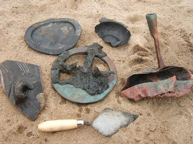 A selection of items from the ship with a trowel below them for scale. The best preserved astrolabe is in the middle, a nice frying pan on the right, some pottery on left, a pewter plate above and a section of a pewter porridge bowel is on the top right. Picture: Dieter Noli Source: Dieter Noli