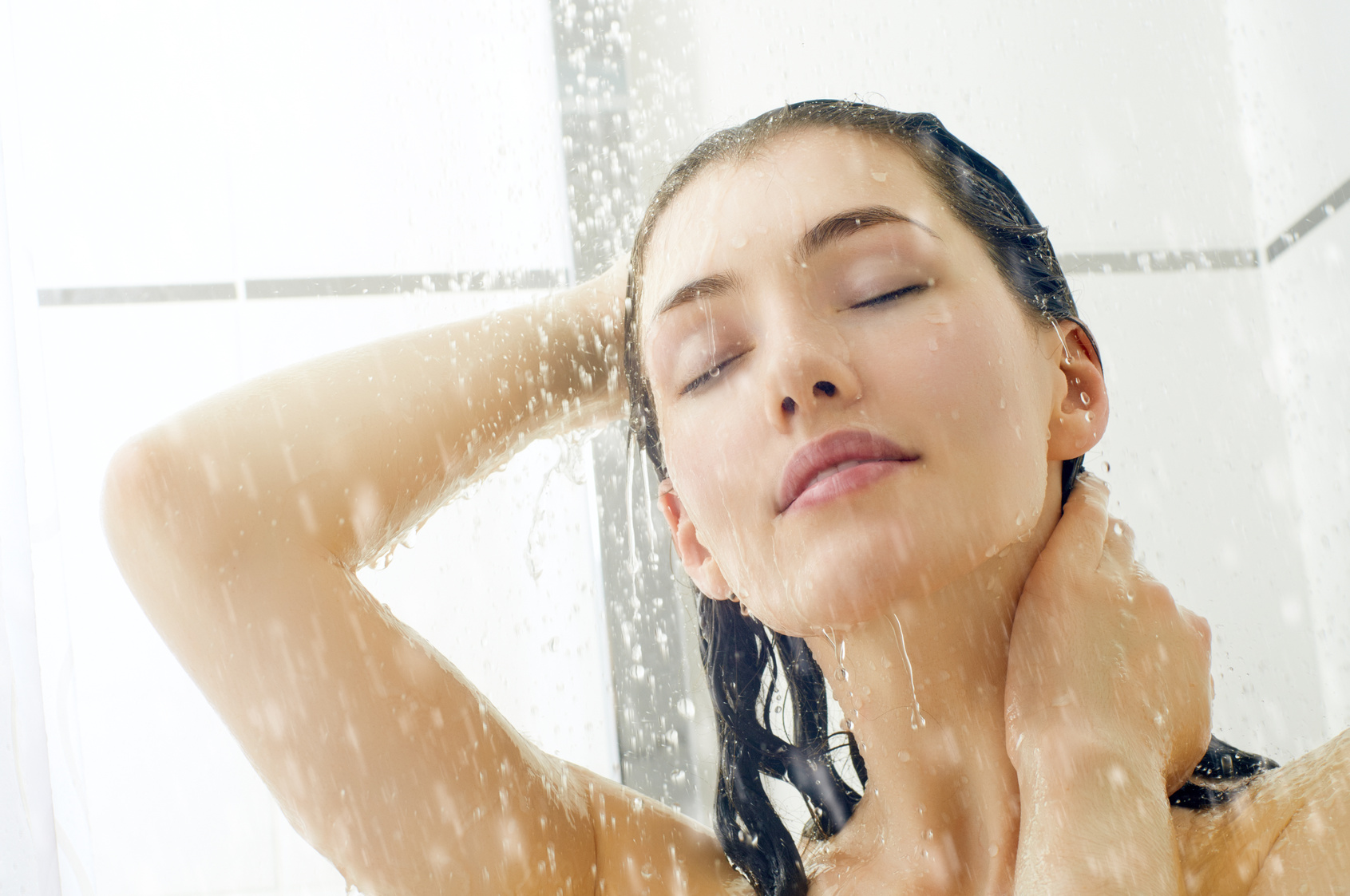 a beautiful girl standing at the shower