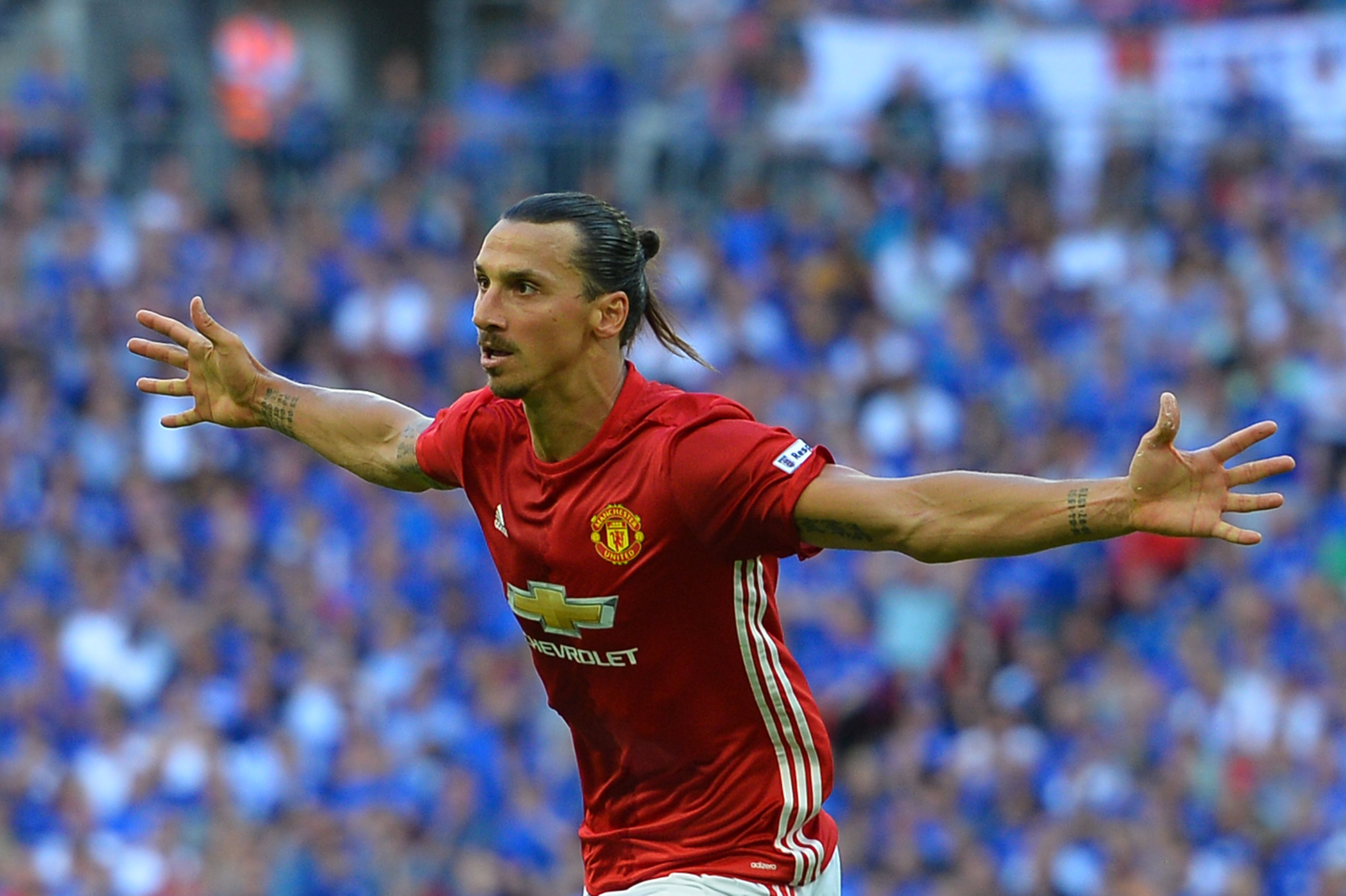 Manchester United's Swedish striker Zlatan Ibrahimovic celebrates scoring their second goal during the FA Community Shield football match between Manchester United and Leicester City at Wembley Stadium in London on August 7, 2016. / AFP PHOTO / GLYN KIRK / NOT FOR MARKETING OR ADVERTISING USE / RESTRICTED TO EDITORIAL USE