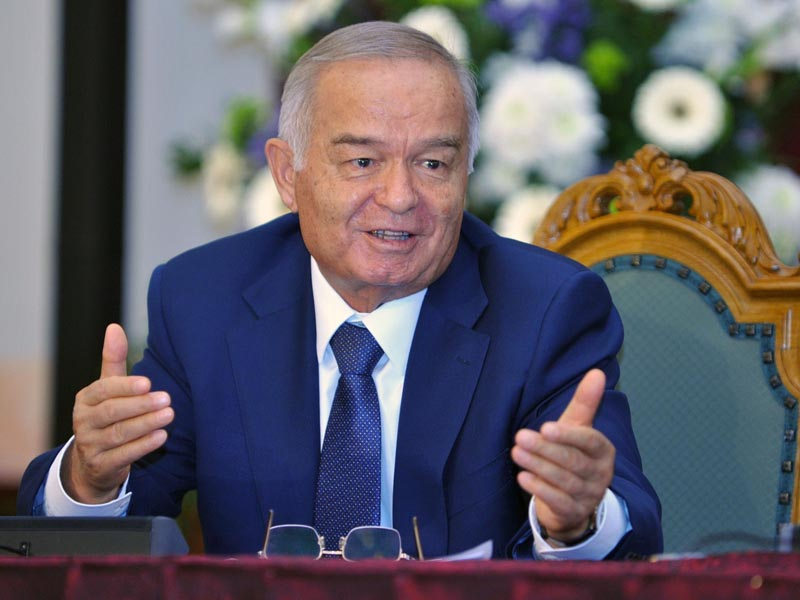 Uzbek counterpart Islam Karimov addresses a press briefing after their meeting in Riga, Latvia, on October 17, 2013. AFP PHOTO / ILMARS ZNOTINS